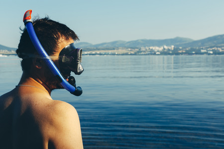 freediving: Young Man Diver With Scuba Mask And Snorkel On Background Of Sea With Space. Tourism Travel Journey Freediving Concept