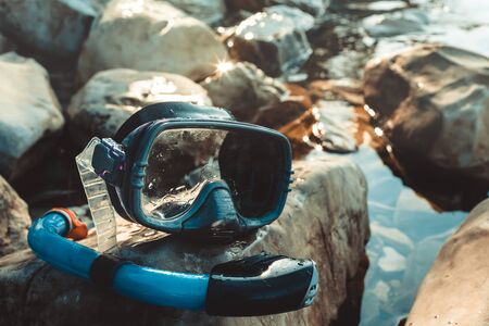 freediving: Mask For Freediving And Snorkel Lie On The Beach, On The Rocks, Closeup. Tourism And Travel Concept