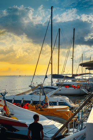 Sailing yacht moored to a pier in a picturesque harbor in the sunset Travel Water Cruise Transport Concept. Gelendzhik, Russia