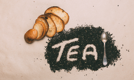 Word Tea Is Made With Small Leaves Black Tea, Toasts And Teaspoon. Top View
