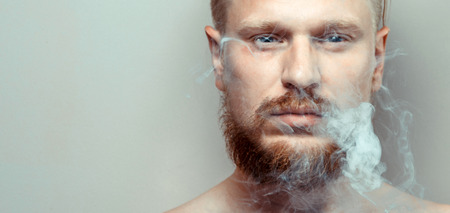 Portrait Of Man Close-up, Cigarette Smoke, Bad Habit Concept Zdjęcie Seryjne