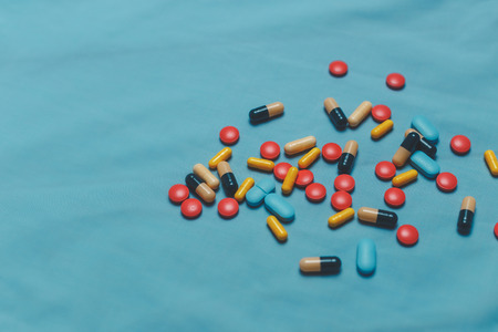 sobredosis: Different Colorful Pills, Tablets And Capsules On Blue Background