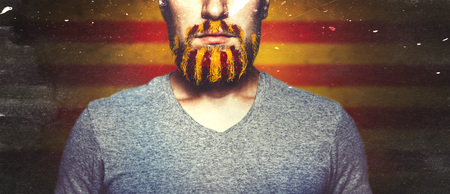 Unrecognizable Young Man With A beard, Unraveled In Colors Of The Flag Of Catalonia. Referendum For The Separation Of Catalonia From Spain. Democracy Independence Concept Stok Fotoğraf