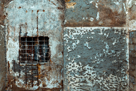 Concrete wall with window and cage, abstract texture