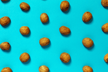 Walnut Shell On Blue Surface. Creative Concept