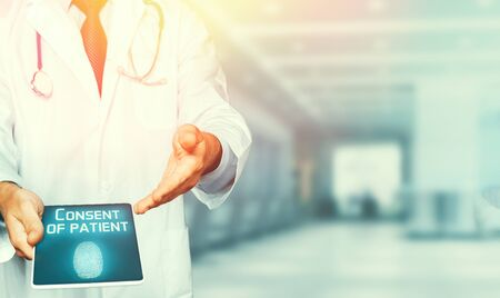 Doctor using a tablet, results of testing and data registration, patient consent in clinic. Healthcare And Medicine Concept