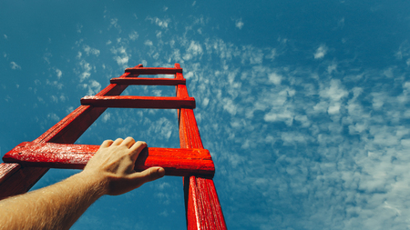 Development Attainment Motivation Career Growth Concept. Mans Hand Reaching For Red Ladder Leading To A Blue Sky Stockfoto - 96134442
