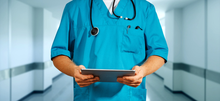 Concept of global medicine and healthcare. Unrecognizable doctor using digital tablet. Diagnostics and modern technology