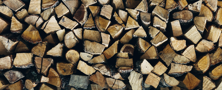 Stack pile of firewood texture pattern background, front view