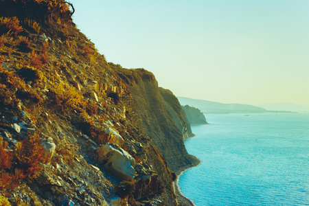 Colorful scenic view of the mountains and the sea in summer. Concept of adventure, vacation, tourism and travel.