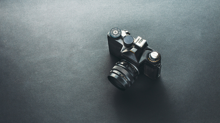 Unrecognizable Old Film Camera On Black Background, Isometric View. Retro In Modern Technology Concept 写真素材