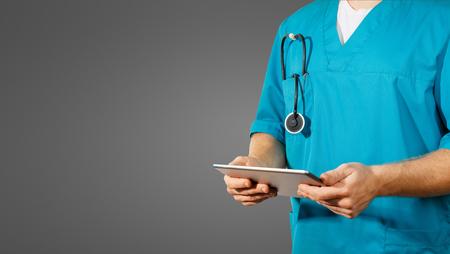 Concept of global medicine and healthcare. Doctor holds digital tablet. Diagnostics and modern technology on black background