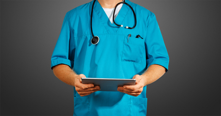 Concept of global medicine and healthcare. Unrecognizable doctor using digital tablet. Diagnostics and modern technology on black background