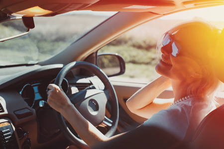 Happy successful adult woman enjoys driving in a road adventure. Holiday vacation travel concept 写真素材