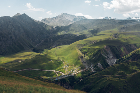 Picturesque Mountain Landscape. Green Hills And Mountain Range On Summer Day. Elbrus Region, Northern Caucasus, Russia