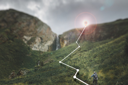 Male traveler climbs the mountain, concept augmented reality in hiking, travel and adventure