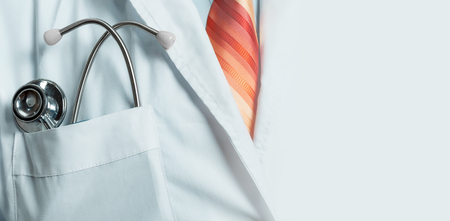 Medicine, Healthcare, Insurance Concept. Doctor with stethoscope, closeup with copy space 写真素材