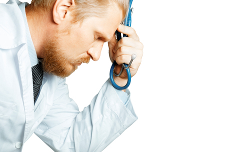 Man Doctor Thinking And Tired. Doctor Is Considering Diagnosis. Patient Care Concept