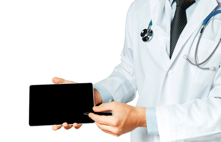 Male Doctor Using Digital Tablet In Consultation With Patient