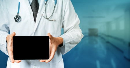 Doctor Holding Blank Digital Tablet With Copy-space And Clipping Path For Screen. Modern Technology In Medicine Concept