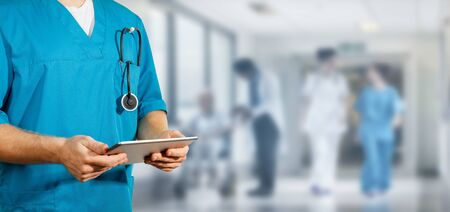 Concept of global medicine and healthcare. Doctor holds digital tablet. Diagnostics and modern technology