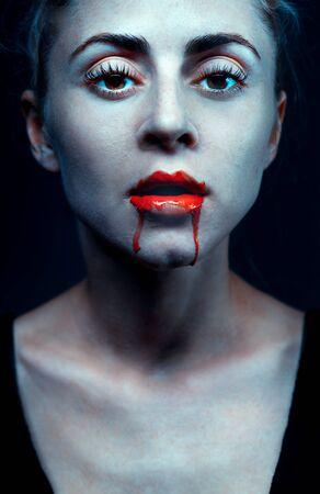 Zombie woman with bloody lips and blue skin portrait. Fashion glamour halloween art design concept