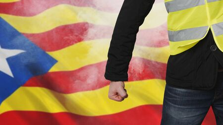 Yellow vests protests in Catalonia. Unrecognizable man clenched his fist in protest separatism concept.