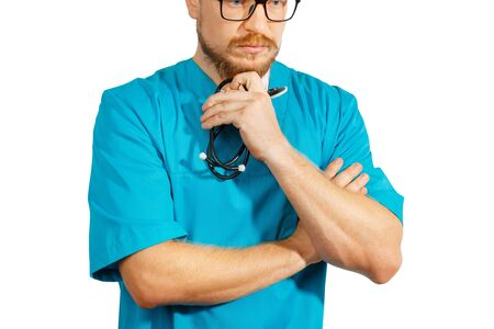 Mature doctor in glasses and blue medical clothes standing with crossed arms. Medicine healthcare, decision making concept Stok Fotoğraf