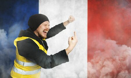 Protest Yellow Vests. Men Raised Hand With Indecent Gesture Middle Finger In Disobedience