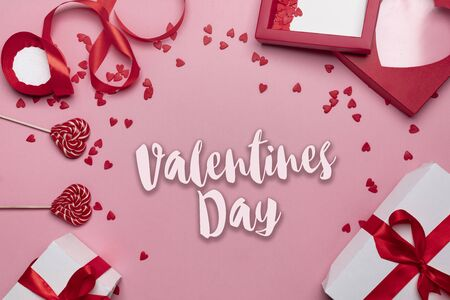 Gifts and hearts on pink background top view. Love. Valentines day background with place for text insertion