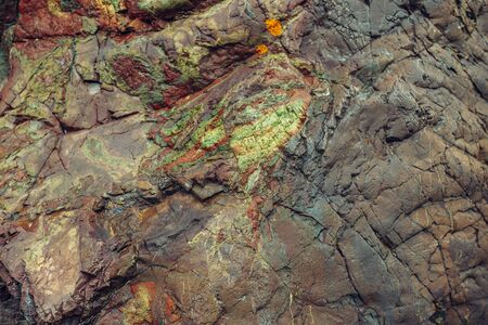Image of mountain of layered rock close up. Brown green blue yellow colors rock formation. Stock fotó