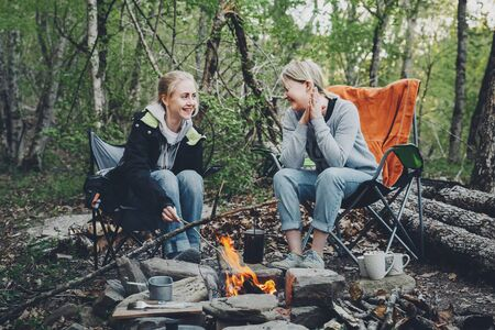 Two young girls enjoy camping vacations