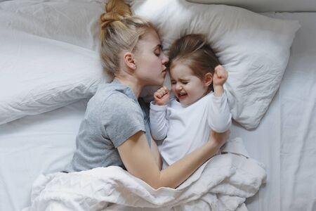Mom Hugs Her Little Daughter, Who Had Nightmare