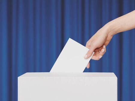 Woman Voter Puts Ballot In Voting Box Standard-Bild