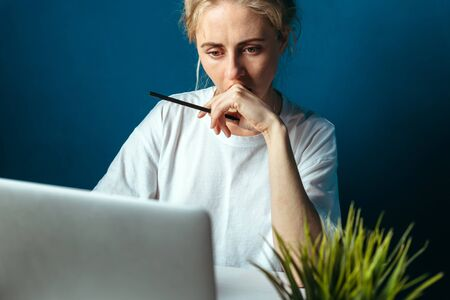 Concentrated Woman Looking At Laptop Screen. Education, Online shopping, Remote Work And Other Meanings Concept
