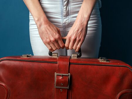 Unrecognizable Woman Holding Red Suitcase In Hands