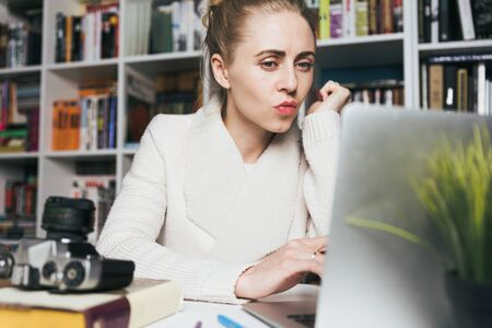 Attractive Woman Uses Laptop. Education, Online shopping, Remote Work And Other Meanings Concept Standard-Bild