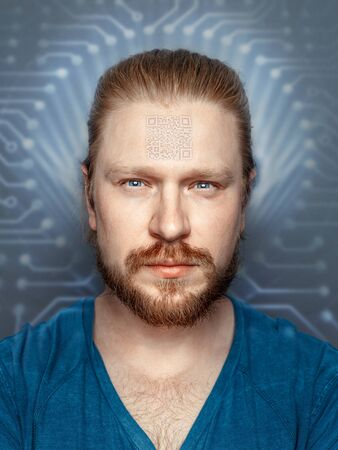 Man With QR Code On Forehead On Background Of Fluorescent Chip, front view portrait