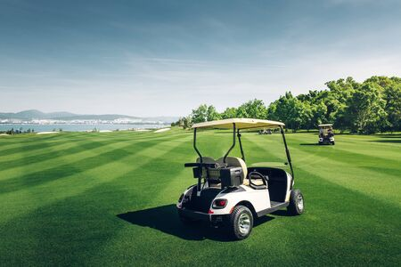 Golfcars Riding On Green Golf Course