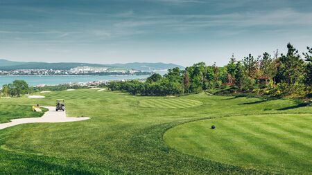 Green Golf Course With Scenic Sea View