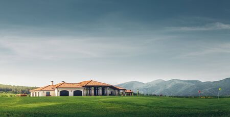 Golf Country Club On Background Of Mountains And Golf Course