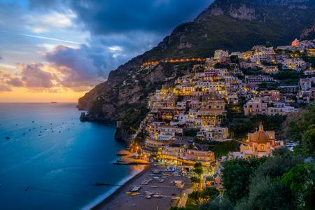 positano: Sunset over Positano near Sorrento at Amalfi Coast in Italy