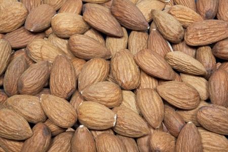 Pile of almonds nuts isolated on white background  Zdjęcie Seryjne