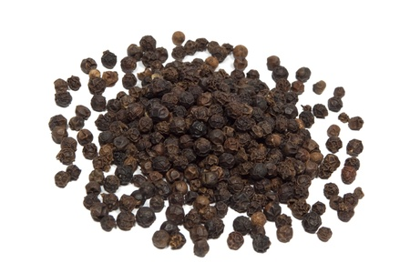 black pepper: Closeup of black pepper isolated on white background  Stock Photo