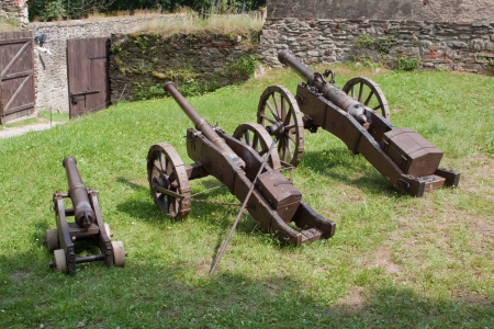 barracks: A line of historical cannons on grass  Stock Photo