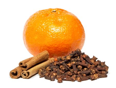 Close-up of cinnamon, clove and orange isolated on white background  photo