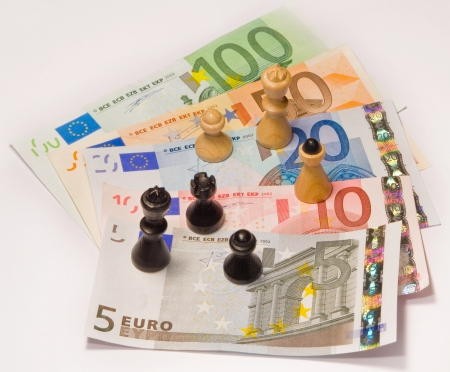 Chess standing on euro currency   photo
