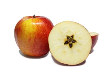 christmas motive: Christmas motive � star on section of apple on white background  Stock Photo
