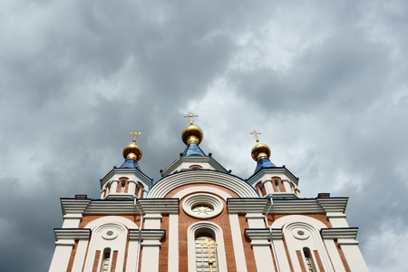 Cathedral against the background of clouds before a thunderstorm Stok Fotoğraf