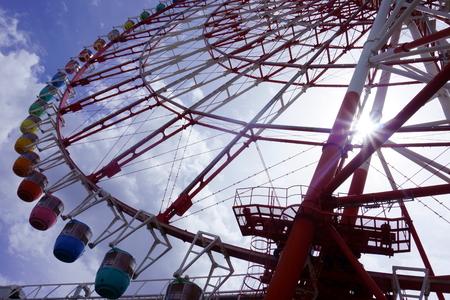 Ferris Wheel Sun Rays. The sun shines through the ferris wheel
